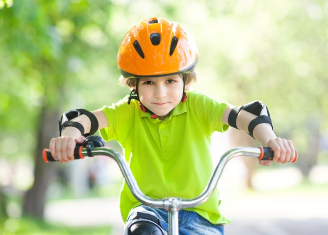 the boy in the protective helmet for bike