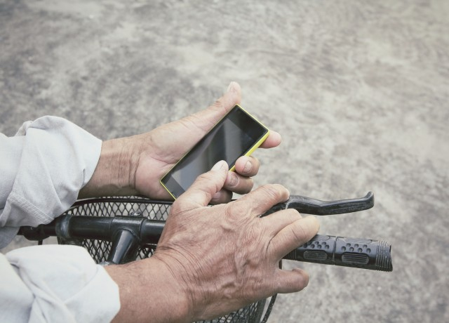 Man using smartphone with bicycle