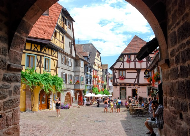 "RIQUEWIHR, FRANCE - JULY 11: town square in Riquewihr, Alsace on July 11, 2010. Riquewihr was fortified in 1291 by Lords of Colmar and now town deserves label of ""most beautiful villages in France"""